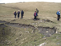 MGA members gathering around the last sealed mine shaft of the walk